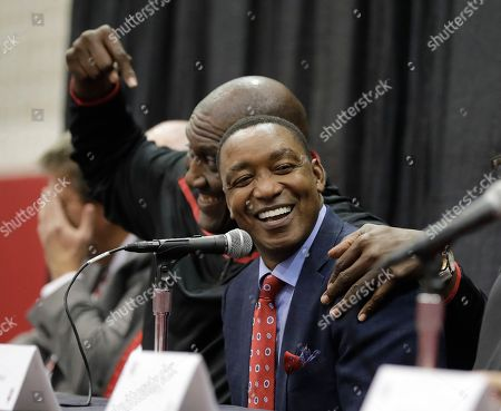 Former Indiana basketball player Ray Tolbert, left, jokes with Isiah Thomas during a news conference before an NCAA college basketball game between Indiana and North Carolina, in Bloomington, Ind. Members of the 1981 NCAA men's basketball championship team held a reunion and will be honored during the game