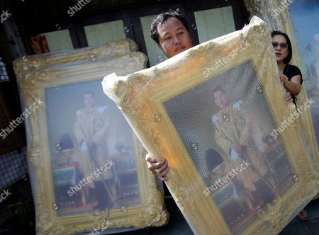Customers purchase portraits of Thailand's Crown Prince Vajiralongkorn in Bangkok, Thailand, . Thailand is preparing to welcome a new king with final arrangements scheduled to formalize the accession of Crown Prince Maha Vajiralongkorn to the throne