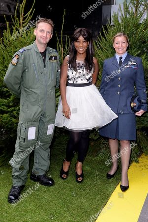 Gala Screening of 'Planes 2: Fire & Rescue' at the Odeon Leicester Square Raf Squadron Leader Nicole Lefthouse and Flight Sergeant Rob Chambers Pose with Pose with Kemi Majeks