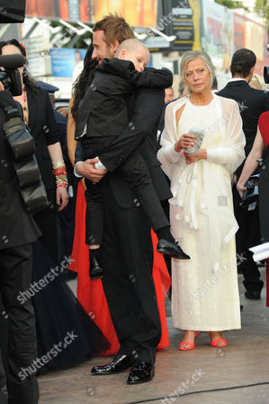 'Rust and Bone' Red Carpet and Gala Openingl at Palais Des Festivals During the 65th Cannes Film Festival Armand Verdure is Carried by Co-star Matthias Schoenaerts