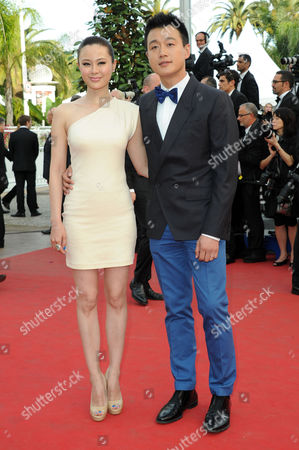 'Rust and Bone' Red Carpet and Gala Openingl at Palais Des Festivals During the 65th Cannes Film Festival Tong Dawei with His Partner