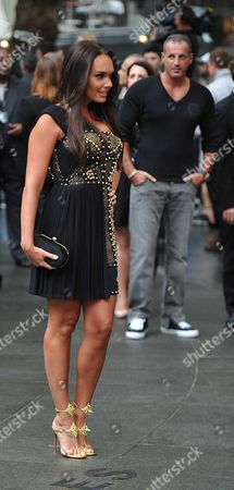 Stock Picture of 'The Dark Night Rises' European Premiere Outside Arrivals at the Odeon Leicester Square Tamara Ecclestone Poses For Photographers While Her Boyfriend Omar Khyami Keeps out of Shot