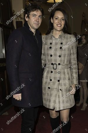 Stock Image of 'The End of Longing' Arrivals at the Playhouse Theatre Phoebe Waller-bridge with Her Husband Conor Woodman