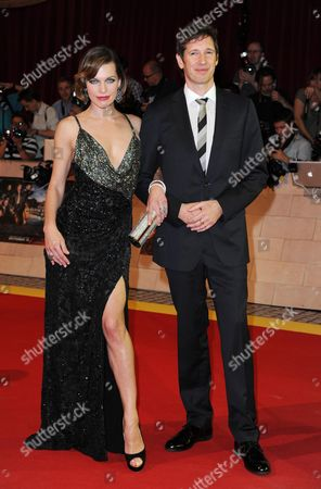 'The Thee Musketeers' World Premiere at Westfield Shopping Centre Shepherds Bush Milla Jovovich with Her Husband Director Paul W S Anderson