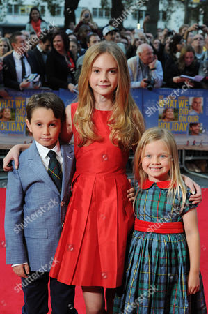 Stock Image of 'What We Did On Our Holiday' Premiere at the Odeon Westend Bobby Smalldridge Emilia Jones and Harriet Turnball
