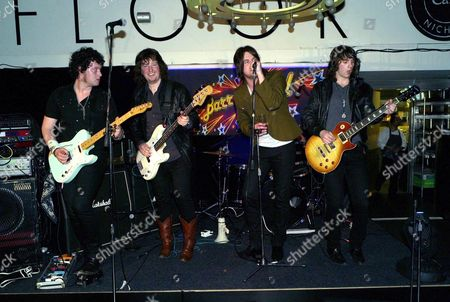 A Celebration of Burns' Night at Harvey Nichol's Knightsbridge London the Haze Jon Bentley On Rhythm Guitar and Vocals Dom Mitchison On Lead Guitar and Backing James Scrancher On Bass and Backing Ross Fowler On Drums