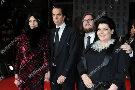 Stock Image of Ee 2015 British Academy Film Awards Arrivals at the Royal Opera House Nick Cave with His Wife Susie Bick with Directors Iain Forsyth and Jane Pollard