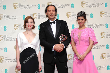 Stock Image of Ee 2015 British Academy Film Awards Press Room at the Royal Opera House Alexandre Desalt - Winner of Best Original Music Ôthe Grand Budapest Hotel' Presented by Holliday Grainger and Nimrat Kaur