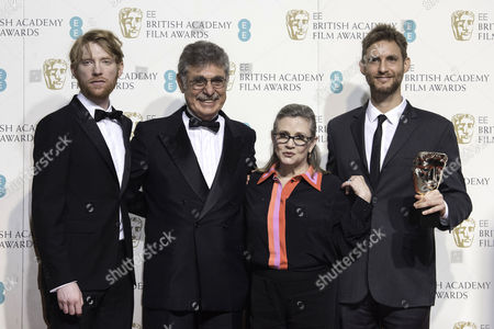 Stock Picture of British Academy Film Awards at the Royal Opera House- Press Room Hugo Sigman and Damian Szifron (film not in the English Language 'Wild Tales' ) Presented by Domhnall Gleeson and Carrie Fisher