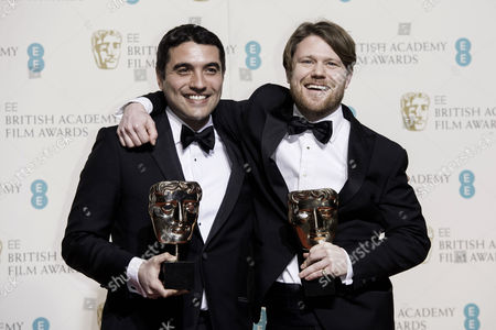 British Academy Film Awards at the Royal Opera House- Press Room Naji Abu Nowar and Rupert Lloyd (outstanding Debut by A British Writer Director Or Producer)