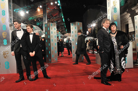 Stock Photo of Ee British Academy Film Awards Outside Arrivals at the Royal Opera House Jeremy Irvine with His Brother Toby Irvine and Dexter Fletcher and His Wife Dalia