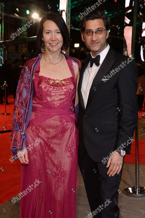 British Academy Film Awards Special Access Arrivals at the Royal Opera House Asif Kapadia with His Wife Victoria Harwood