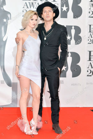Brit Awards 2016 at the O2 - Arrivals Carl Barat and Edie Langley