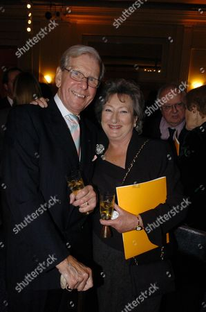 The Veuve Clicquot Award to the Business Women of the Year at Claridges Hotel Bob Holness with His Wife