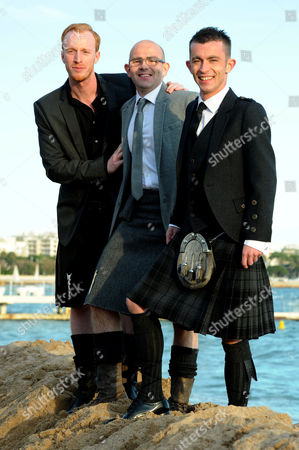 Stock Image of Cast of 'The Angel's Share Photographed at the Creative Scotland Reception at Long Beach During the 65th Cannes Film Festival William Ruane Gary Maitland and Paul Brannigan