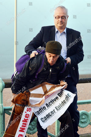 Labour Party Conference Brighton While Conducting Early Morning Television Interviews On the Brighton Seafront His Book Publisher Iain Dale Tries to Prevent Protester Stuart Holmes From Interfering with and Getting Into the Back of the Interviews