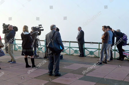 Labour Party Conference Brighton While Conducting Early Morning Television Interviews On the Brighton Seafront His Book Publisher Iain Dale Tries to Prevent Protester Stuart Holmes (far Right) From Interfering with and Getting Into the Back of the Interviews