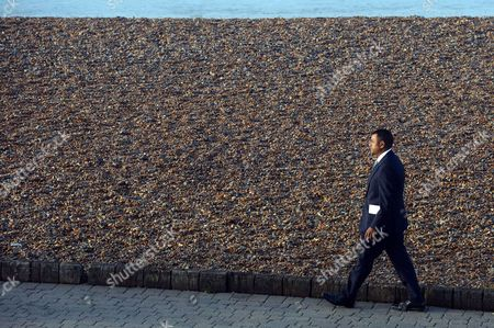 Stock Picture of Labour Party Conference Brighton Lord Waheed Alli Takes A Early Morning Walk Along the Beach