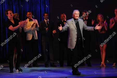 Stock Photo of Singing Legend Bill Medley (the Righteous Brothers) is Invited Up On Stage by 'Johnny Castle' Played by Paul-michael Jones at the End of 'Dirty Dancing' at London's Piccadilly Theatre Famous For Singing '(i've Had) the Time of My Life' Medley is in London This Week to Promote His First Ever Uk Concert at Wembley Arena in November