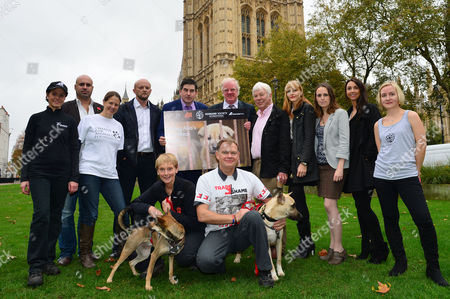 Dog Meat Trade Debate Photocall at the Houses of Parliament Michelle Ballard (animals Asia); Marc Abraham (tv Vet); Suzanna Rogers (change For Animals); Keith Taylor; Rob Flello Mp; Edward Leigh Mp; John Hawkridge (international Wildlife Coalition Trust) Marissa Heath (all Party Group For Animal Welfare); Claire Bass (executive Director of Humane Society International/uk); Shoshannah Mitchell; Wendy Higgins (humane Society International/uk); Marigold Gunter with Dog Holly & Gary Baxter