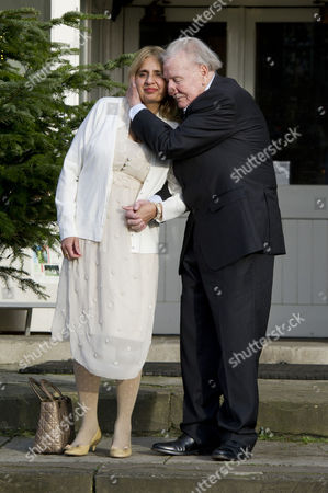 Stock Image of Leslie Phillips with His New Wife Zara Carr at Their Wedding Blessing at St Mark's Church Maida Vale