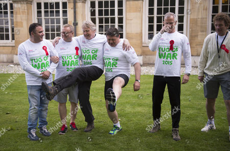 Stock Picture of 02 06 2015 Macmillan's House of Lords Vs House of Commons Tug of War Westminster College Gardens London the Mp's Team James Heappey Mp Kris Hopkins Mp Graham Evans Mp David Burrows Mp Chris Law Mp Angus Macneil Mp Alec Shelbrooke Mp Mark Spencer Mp & Mike Penning Mp