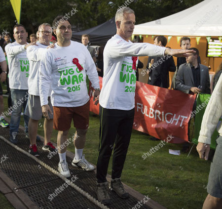 02 06 2015 Macmillan's House of Lords Vs House of Commons Tug of War Westminster College Gardens London Rafael Ballesteros Lord Collins of Highbury Lord Karan Bilmoria & Lord Brian Paddick