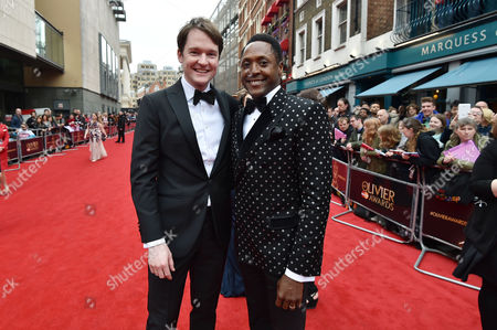 Stock Image of Olivier Theatre Awards at the Royal Opera House - Special Access Red Carpet Pre-show Reception and Auditorium Matt Henry and Killian Donnelly