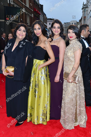 Olivier Awards Red Carpet Arrivals at the Royal Opera House Gurinder Chadha and Natalie Dew