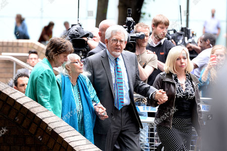 Rolf Harris Leaves Southwark Crown Court After the Jury Returned with A Guilty Verdict of 12 Counts of Indecently Assaulting Four Girls From the 60's to the 80's Rolf Harris Leaves Court with His Wife Alwen Hughes and Daughter Bindi