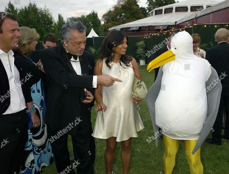 Stock Picture of Royal Parks Foundation Gala at the Serpentine Lido Hyde Park Joel and Divia Cadbury with Her Father Gulu Lalvani (l)