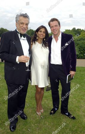 Stock Photo of Royal Parks Foundation Gala at the Serpentine Lido Hyde Park Joel and Divia Cadbury with Her Father Gulu Lalvani (l)