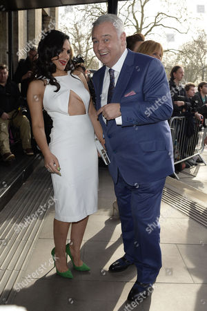 Stock Image of Tric Awards Arrivals at the Park Lane Hotel Nazaneen Ghaffar and Eamonn Holmes