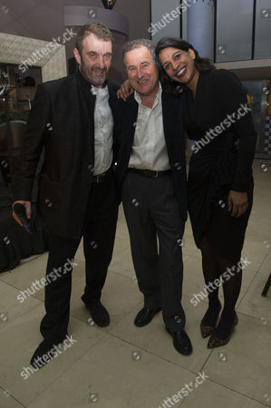 Stock Image of Tricycle Theatre's Annual Fundraiser Drinks Reception at Quaglino's Mayfair Jonathan Levy (chairman of the Board) with Nicolas Kent and Indhu Rubasingham Nicholas Kent is Stepping Down As Director of the Tricycle with Indhu Taking Over