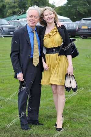 Veuve Clicquot Gold Cup Final Polo at Cowdray Park West Sussex Nickolas Grace with His Chariots of Fire Co-star Antonia Bernath