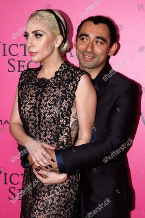 Nicola Formichetti and Lady Gaga pose for photographers during the pink carpet before the Victoria's Secret fashion show in Paris. The pulse-quickening, celebrity-filled catwalk event of the year: the Victoria's Secret fashion show takes place in Paris with performances from Lady Gaga and Bruno Mars