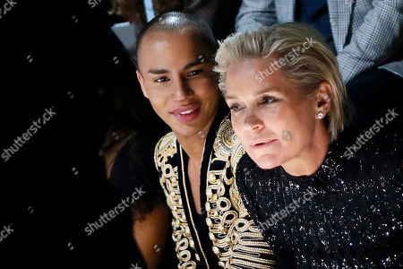 Stock Photo of French fashion designer Olivier Rousteing, left, and Yolanda Hadid look on during the Victoria's Secret Fashion Show inside the Grand Palais, in Paris, . The pulse-quickening, celebrity-filled catwalk event of the year : the Victoria's Secret fashion show tskes place in Paris with performances from Lady Gaga and Bruno Mars