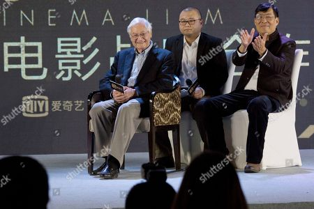 """American film producer Roger Corman, left, attends a news conference to announce co-production between Chinese online video site iQIYI and Sony Pictures in Beijing, China, . The 90-year-old American producer of films including """"The St. Valentine's Day Massacre"""" and """"Attack of the 50 Foot Cheerleader"""" will lead a team of young Chinese filmmakers and act as producer on a sci-fi film made for viewing on the internet or mobile phone called """"Invasion"""