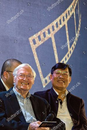 """American film producer Roger Corman, left, attends a news conference to announce the co-production between Chinese online video site iQIYI and Sony Pictures in Beijing, China, . The 90-year-old American producer of films including """"The St. Valentine's Day Massacre"""" and """"Attack of the 50 Foot Cheerleader"""" will lead a team of young Chinese filmmakers and act as producer on a sci-fi film made for viewing on the internet or mobile phone called """"Invasion"""