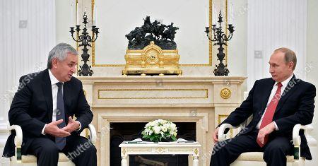 Russian President Vladimir Putin, right, and leader of Georgia's breakaway province of Abkhazia Raul Khajimba meet in the Kremlin in Moscow, Russia on