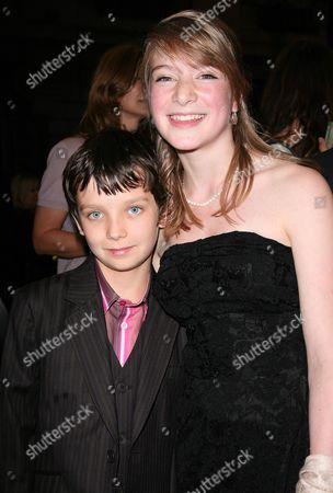 Reception Before the World Premiere of 'The Boy in the Striped Pyjama's' at 17 Berkeley Street at the Curzon Mayfair Amber Beattie with Asa Butterfield