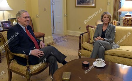 Stock Photo of Mitch McConnell, Betsey DeVos Senate Majority Leader Mitch McConnell of Ky., left, left, sits in his office with Betsy DeVos, right, President-elect Donald Trump's nominee for Education Secretary, before the start of their meeting on Capitol Hill in Washington