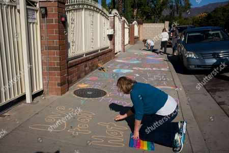 Stock Picture of Karen Fagan, Kate Bowman Karen Fagan, joined by her daughters, Kate and Elizabeth Bowman in rear, writes chalk messages on the sidewalk outside the Islamic Center of Claremont in Pomona, Calif., to show their support for Muslim communities. Fagan's ex-husband and her two daughters' father, Harry Bowman, was killed in the Dec. 2, 2015, terror attack at the Inland Regional Center in San Bernardino, Calif