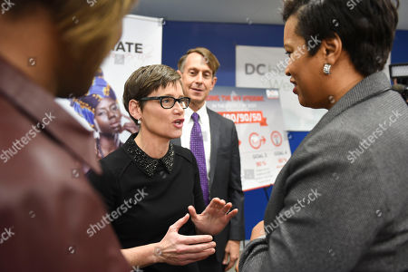 Muriel Bowser, Nancy Mahon Senior Vice President of MAC Cosmetics Nancy Mahon, center, talks with D.C. Mayor Muriel Bowser, right, following an announcement at the DC Health and Wellness Center on ending the HIV/AIDS epidemic in the district, in Washington