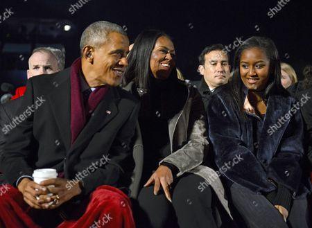 Barack Obama, first lady Michelle Obama, and Sasha Obama listen to the performances