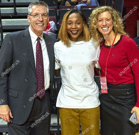 Piscataway, New Jersey, U.S. - Former player Cappie Pondexter talks with AD Pat Hobbs, left, and Sarah Baumgartner, senior associate athletic director, before the game. Cappie's number 25 was retired at halftime during NCAA basketball action between the Duke Blue Devils and the Rutgers Scarlet Knights at Rutgers Athletic Center in Piscataway, New Jersey