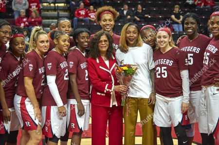 Piscataway, New Jersey, U.S. - Rutgers head coach C. Vivian Stringer and former player Cappie Pondexter with current team before NCAA basketball action between the Duke Blue Devils and the Rutgers Scarlet Knights at Rutgers Athletic Center in Piscataway, New Jersey. Cappie's jersey #25 was retired at halftime