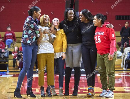 Piscataway, New Jersey, U.S. - Former Rutgers player Cappie Pondexter celebrates with former teammates as her jersey #25 was retired at halftime during NCAA basketball action between the Duke Blue Devils and the Rutgers Scarlet Knights at Rutgers Athletic Center in Piscataway, New Jersey