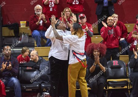 Piscataway, New Jersey, U.S. - Former Rutgers player Cappie Pondexter celebrates with her mother as her jersey #25 was retired at halftime during NCAA basketball action between the Duke Blue Devils and the Rutgers Scarlet Knights at Rutgers Athletic Center in Piscataway, New Jersey
