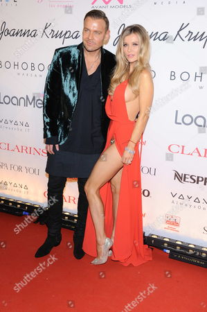 Joanna Krupa with designer Dawid Wolinski